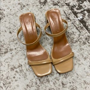 Nude patent sandals